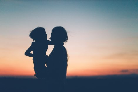 Woman and child sunset